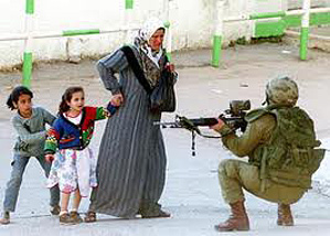 Soldier with gun, woman with children